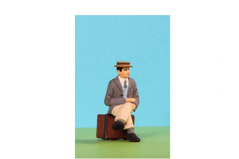 -  - 48/A032 Sitting man wearing Boater