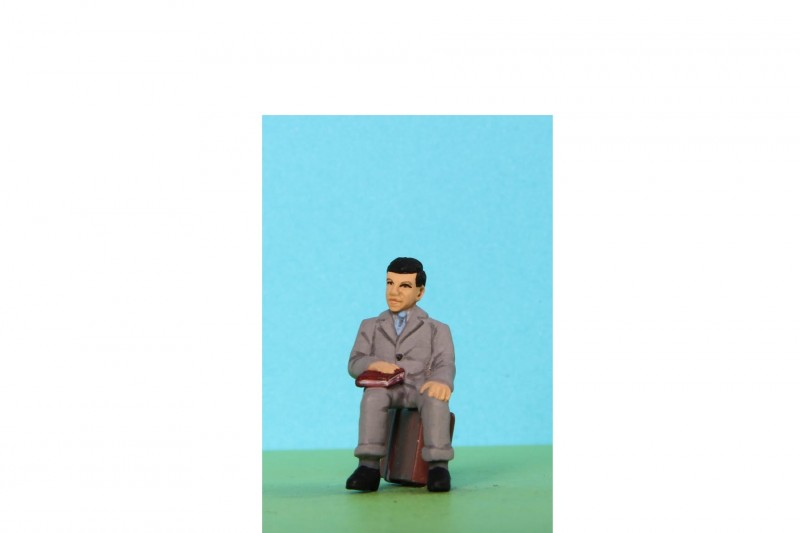 -  - 48/A091 Sitting man holding book