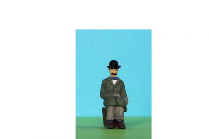 -  - 48/A094 Man sitting in bowler hat