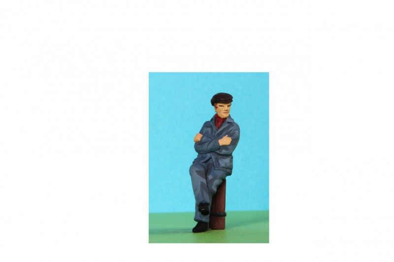 -  - 48/A179 Sitting workman legs cross arms folded