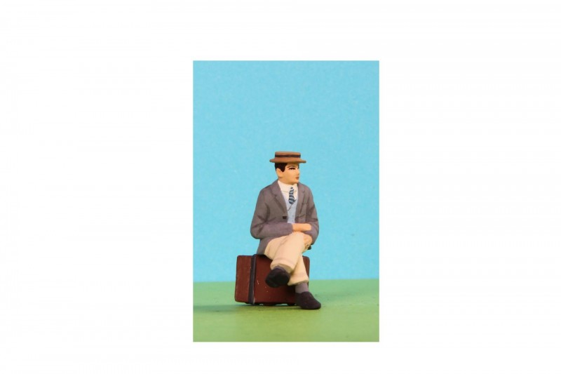 -  - A032 Sitting Man wearing boater